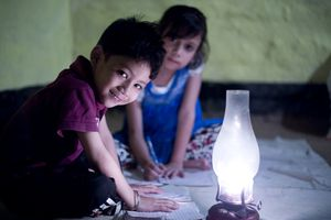 Rural girl and boy studying in lantern