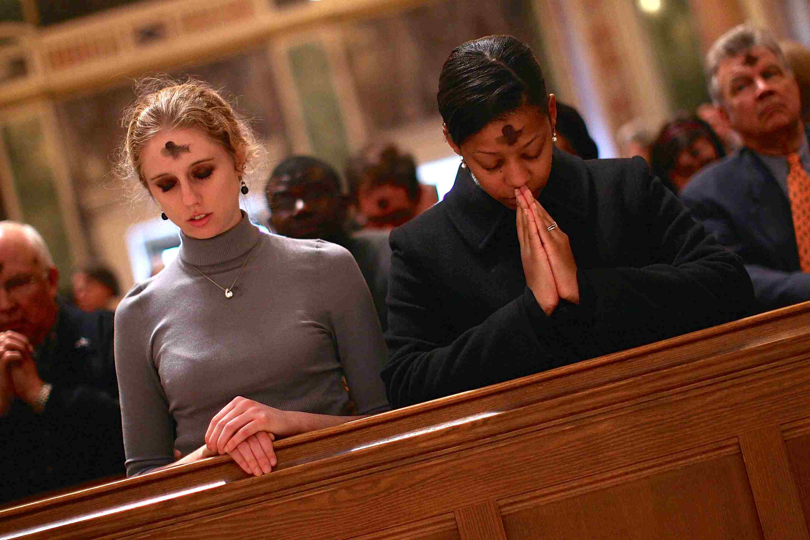 Catholics observing ash wednesday at St. Matthew Cathedral