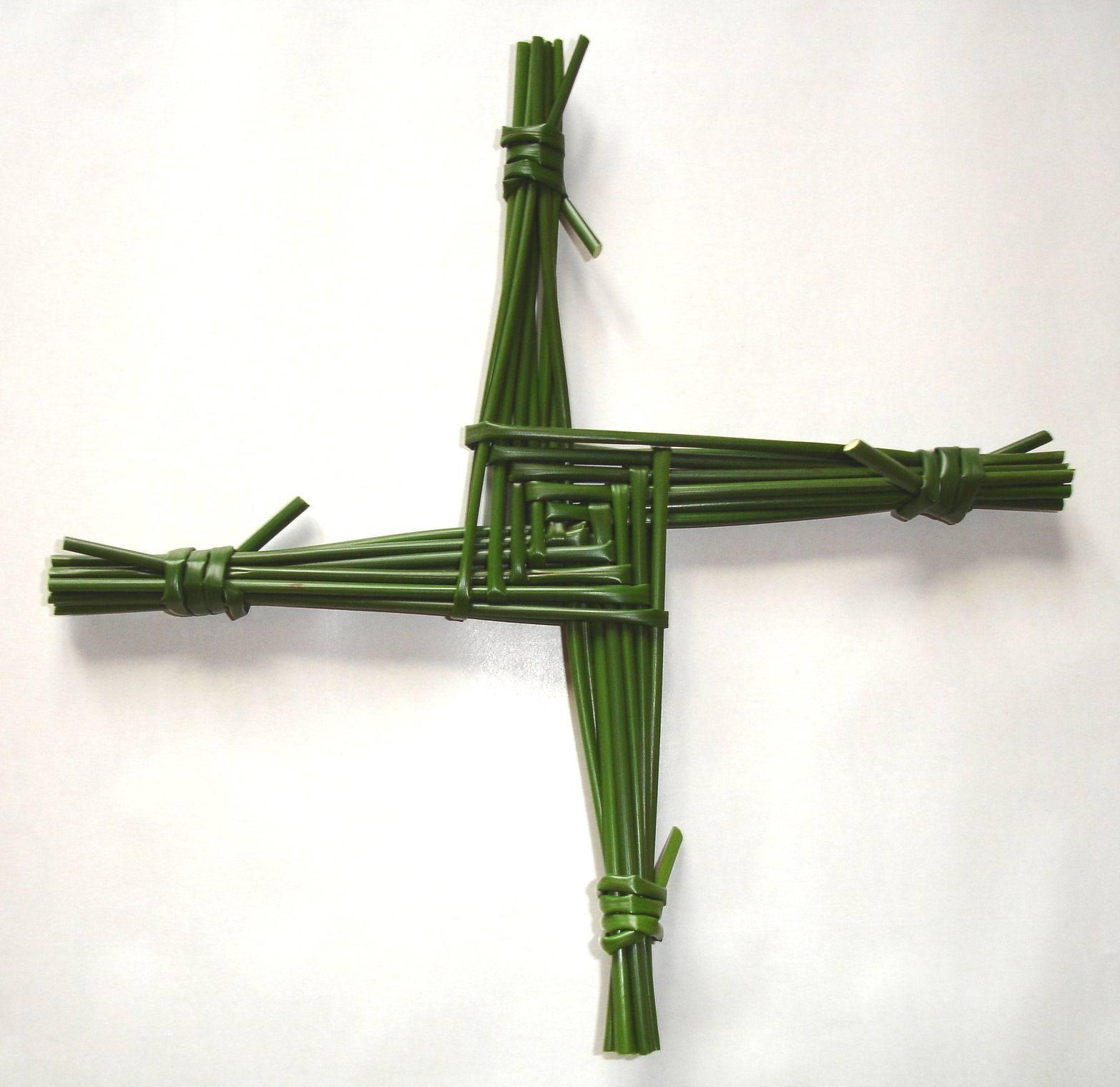A handmade Brigid's cross against white background.