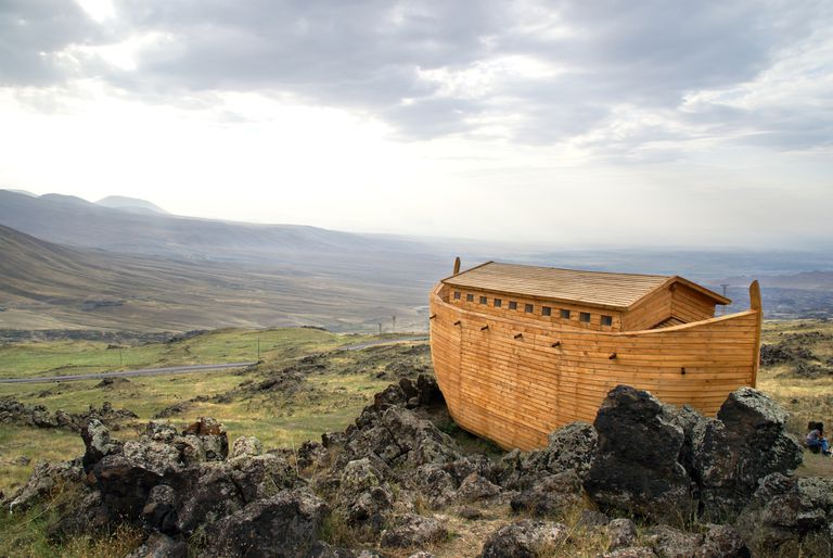 Noah's Ark docked on rocks overlooking a landscape