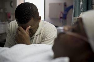 Man praying in hospital