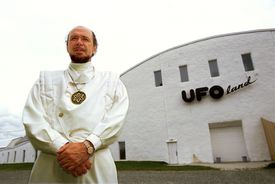 Claude Vorilhon's (aka, Rael) standing in front of a Raelian building.