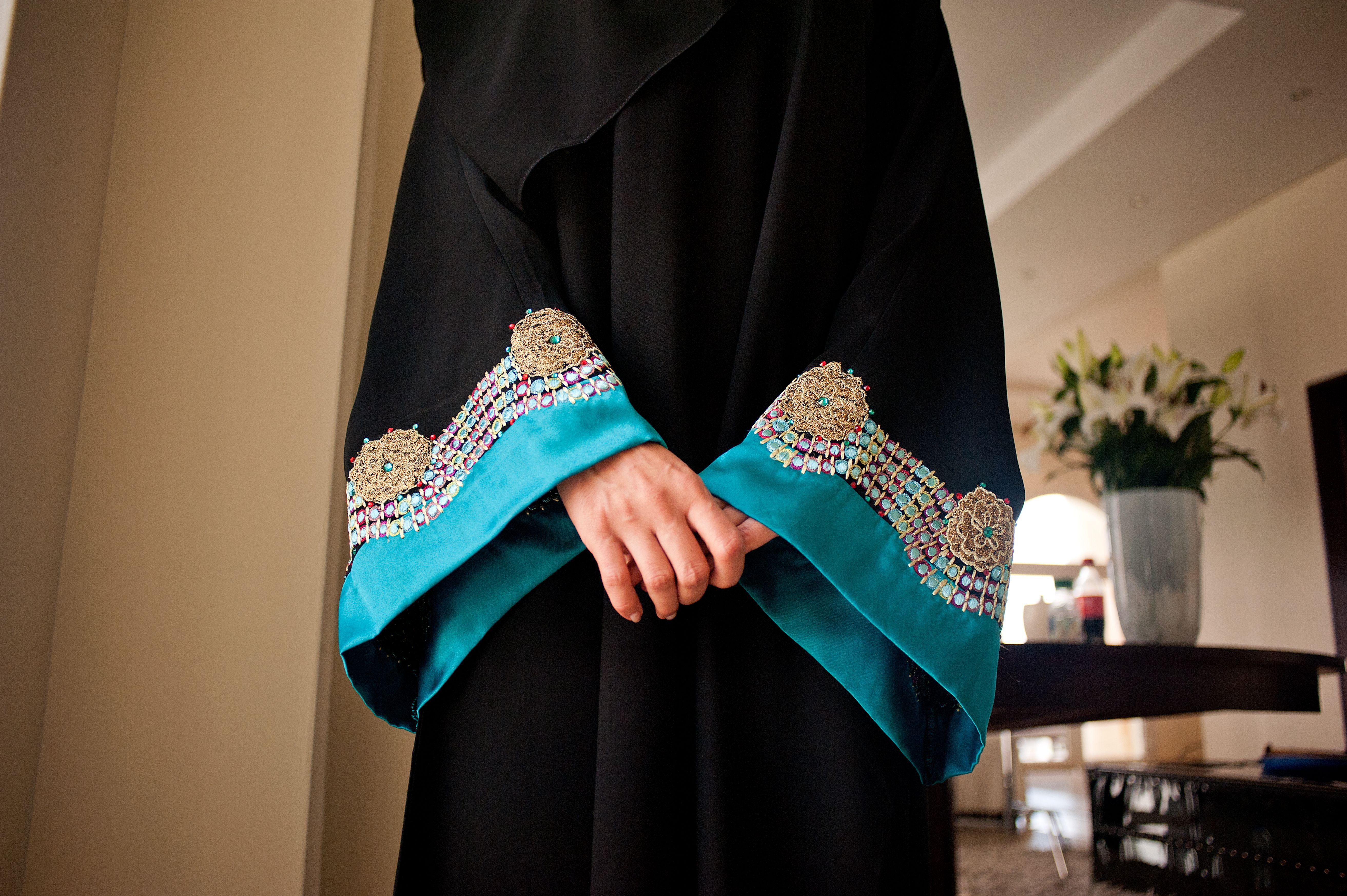 A woman wearing an abaya with colorful sleeves