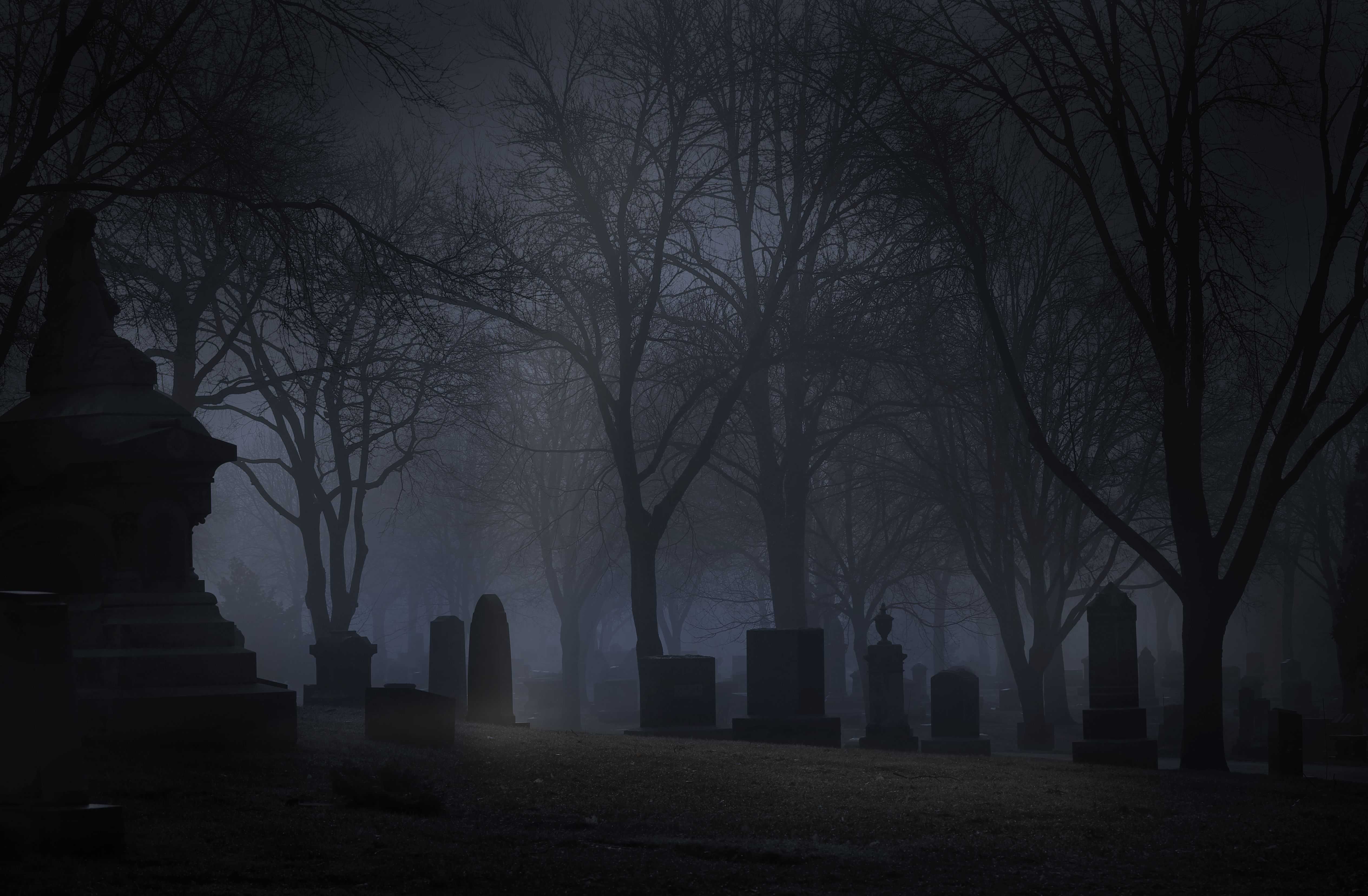 Spooky Cemetery at night with fog