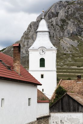 Church clock tower and mountains