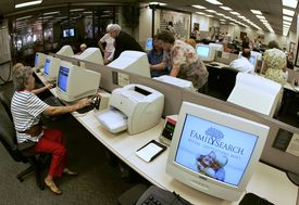 People do computer research at the Mormon Church's genealogy library July 15, 2004 in downtown Salt Lake City, Utah