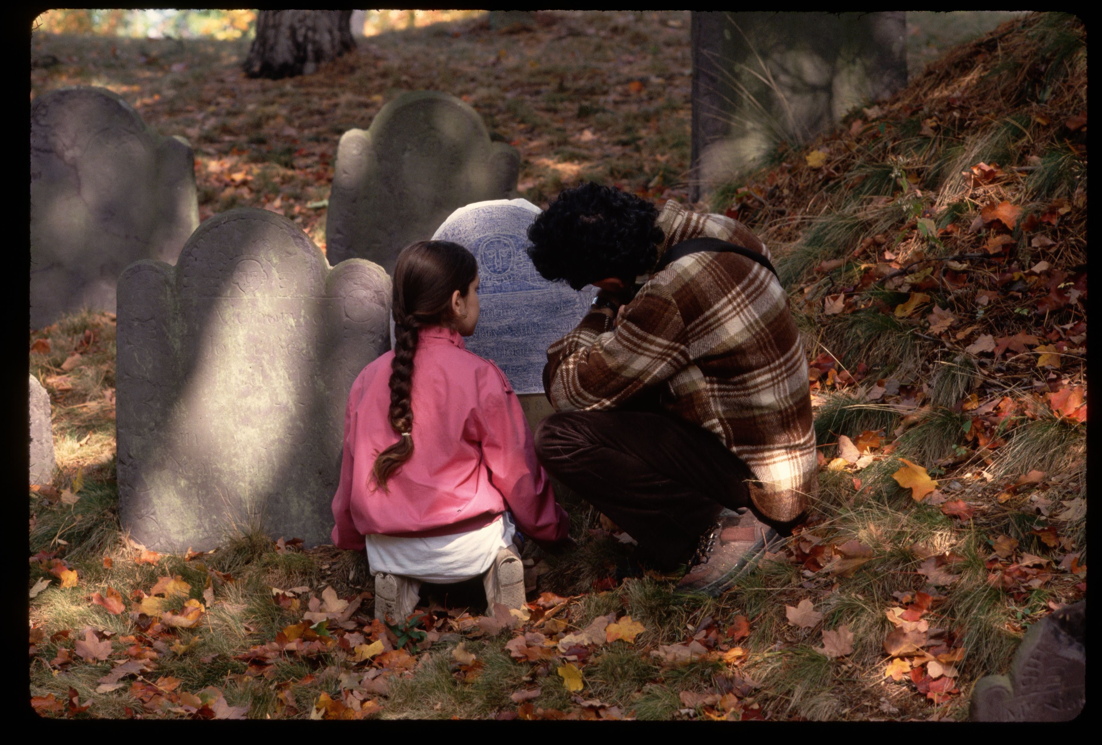 Tourists Rubbing Colonial Graves at Massachusetts Cemetery