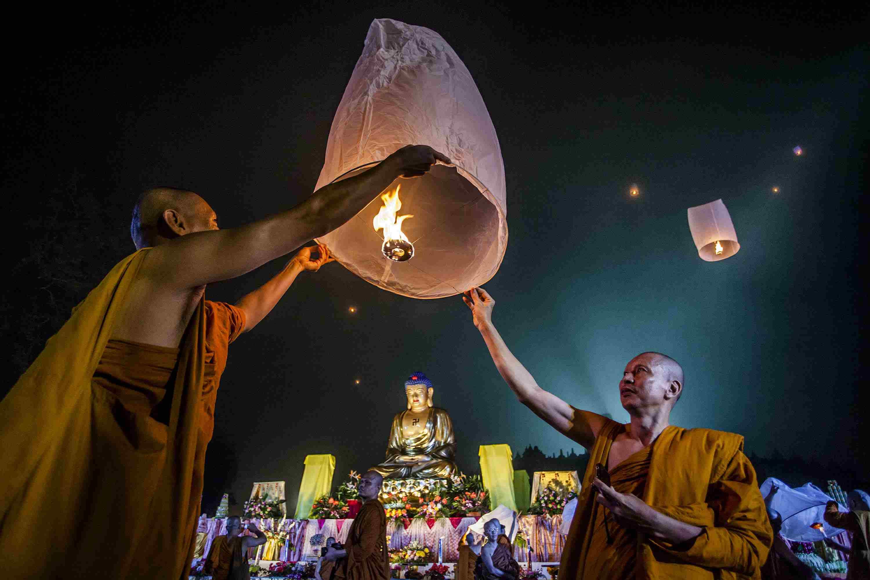 Monks release a lantern into the air at Borobudur temple, Indonesia, during Vesak celebrations.
