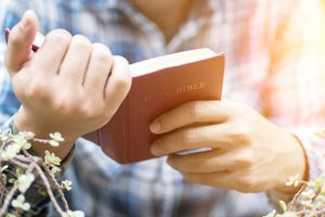 Man Holding the Bible