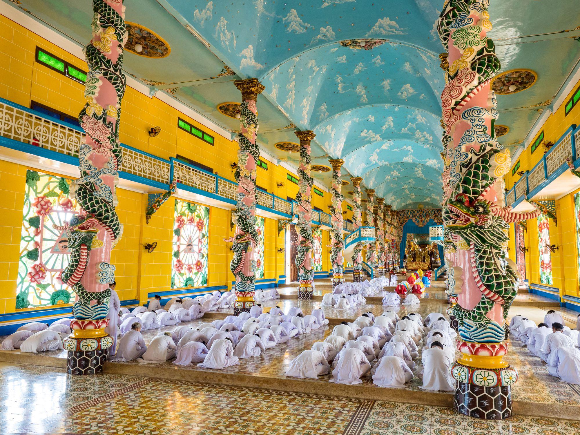 The Cao Dai Faithful in Cao Dai Holy See Temple At Morning Prayer