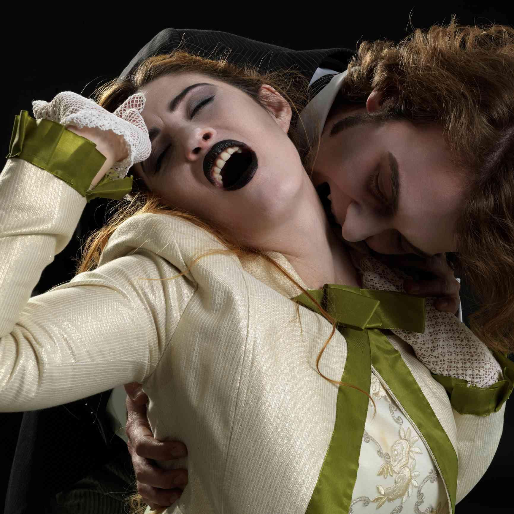 Vampire biting Victorian woman