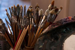 Close-Up Of Paintbrushes In Containers