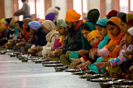 Thousands of Sikh pilgrims get free meals at the Langar of the Golden Temple