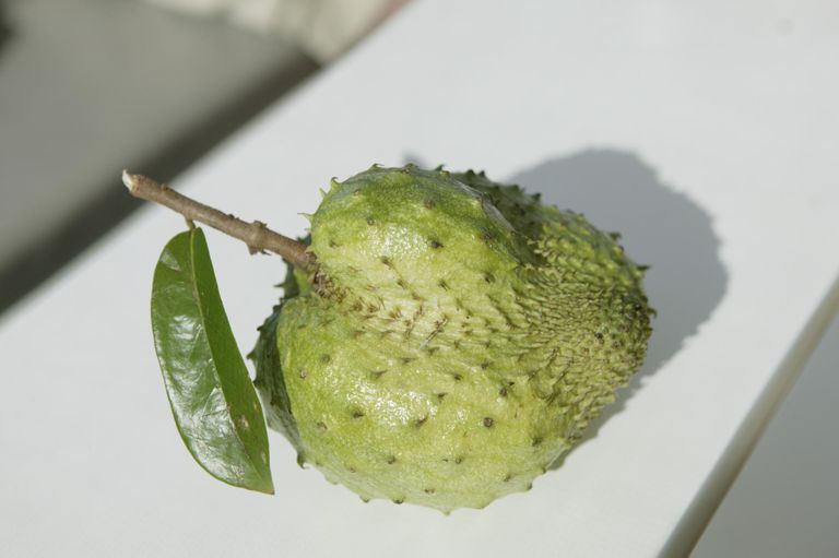 A Soursop fruit on a white surface