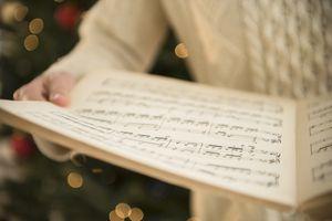woman holding sheet music