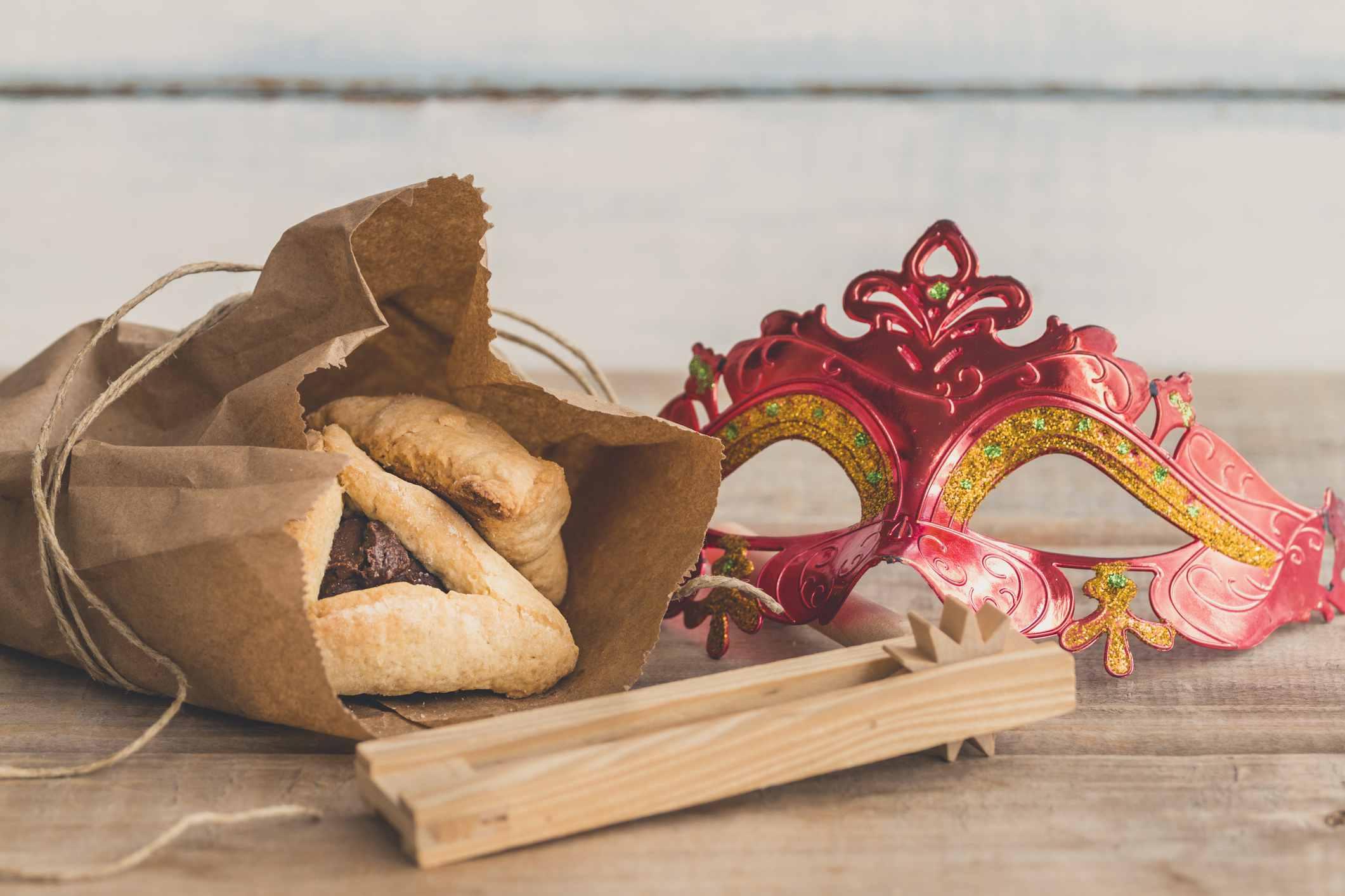 Hamantaschen, Purim mask and Purim Gragger