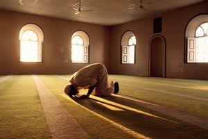 Muslim man praying in mosque.