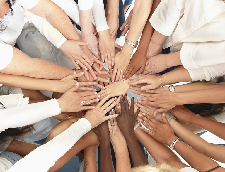 Hand of Diverse Women Huddling