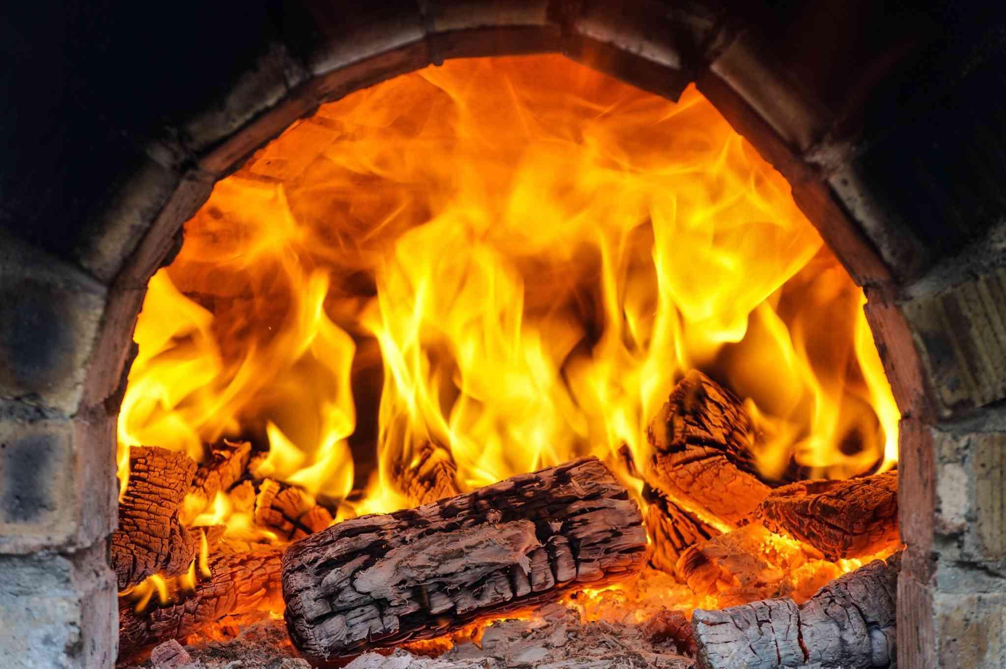 Logs Burning In Fireplace