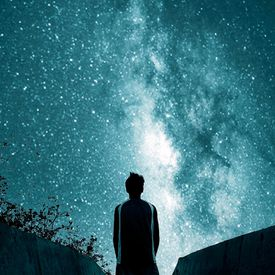 Contemplating existence against a starry sky