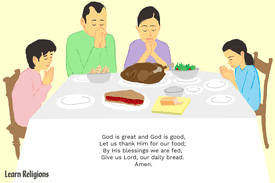A family praying at a dinner table, with this prayer superimposed over the image: