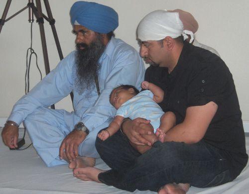 Grandfather Dedicates Newborn Grandchild to the Guru