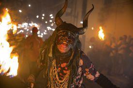 Person in a Demon Costume at a Festival