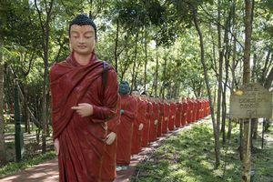 Statues of Monks Walking Behind Buddha, Temple of 500 Arhats, Sri Lanka