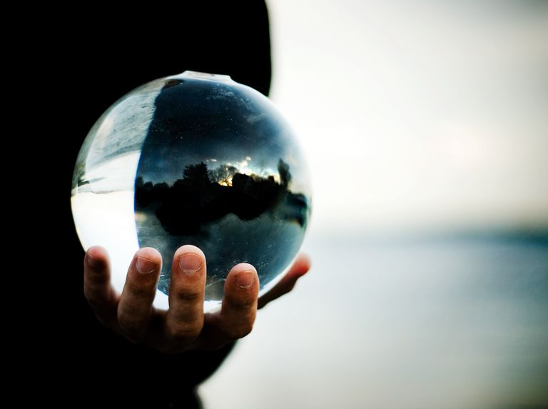 Man holding a glass ball