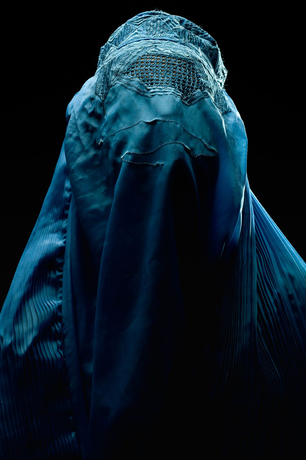 A woman wearing a blue burqa common in Afghanistan.