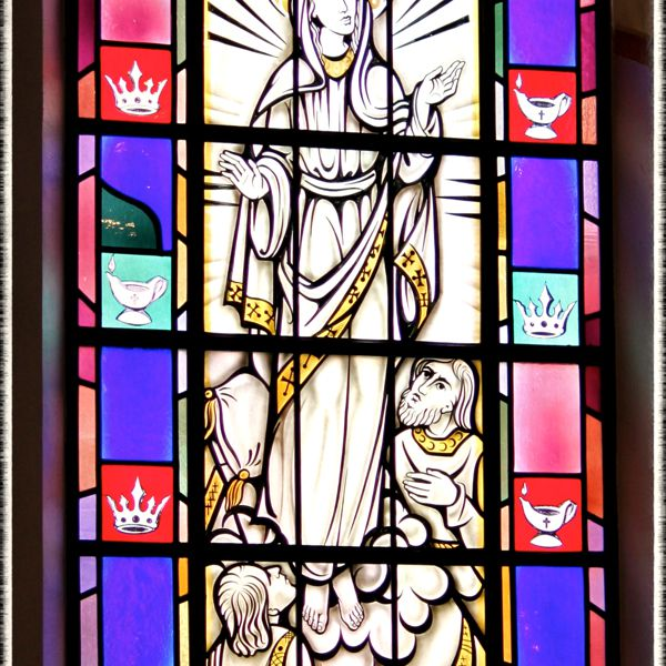 Stained-glass window of the Assumption in Saint Mary's Church, Painesville, OH. (© Scott P. Richert)