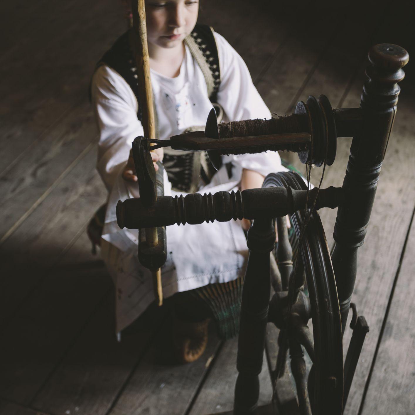 Child at spinning wheel