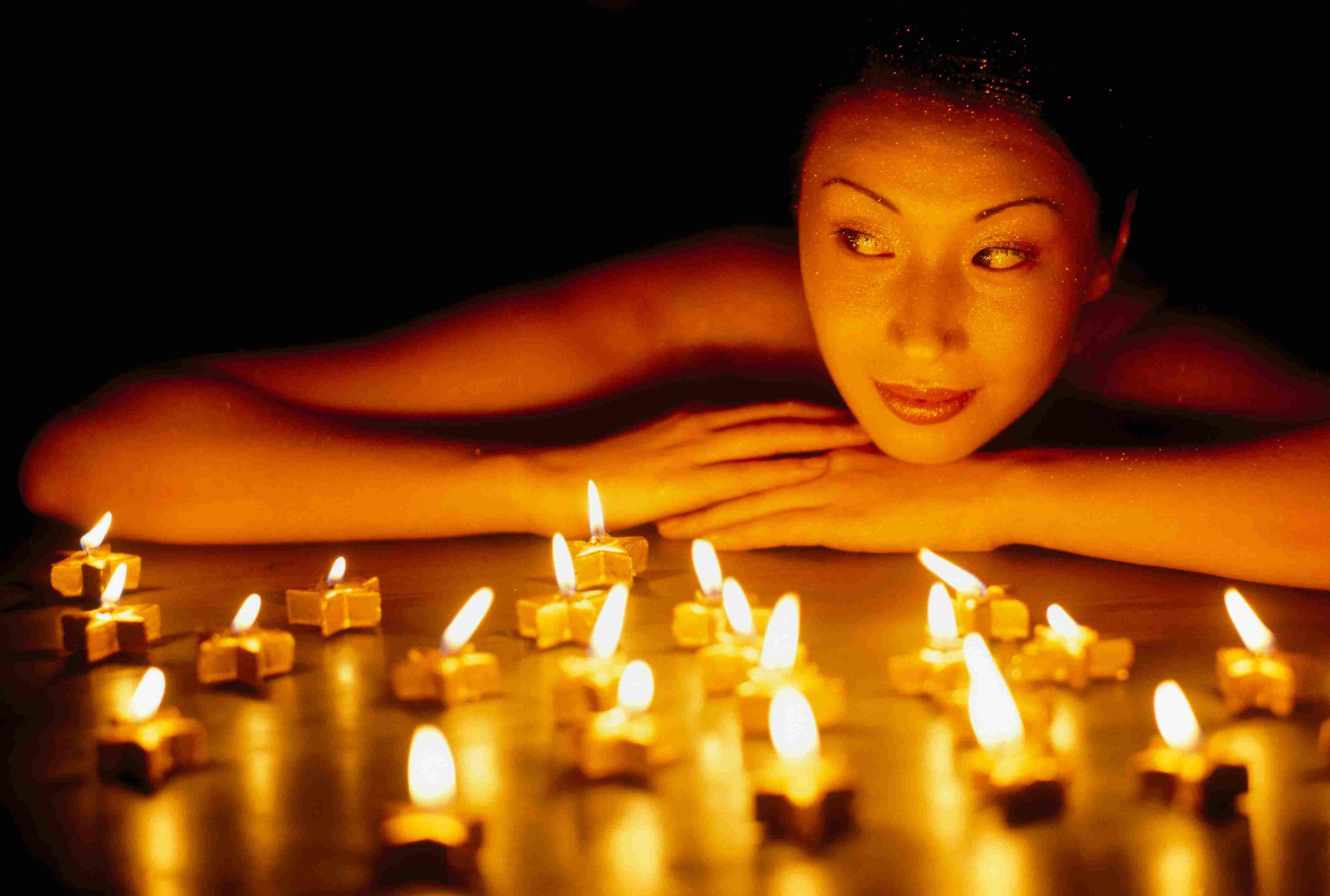 Woman looking at candles