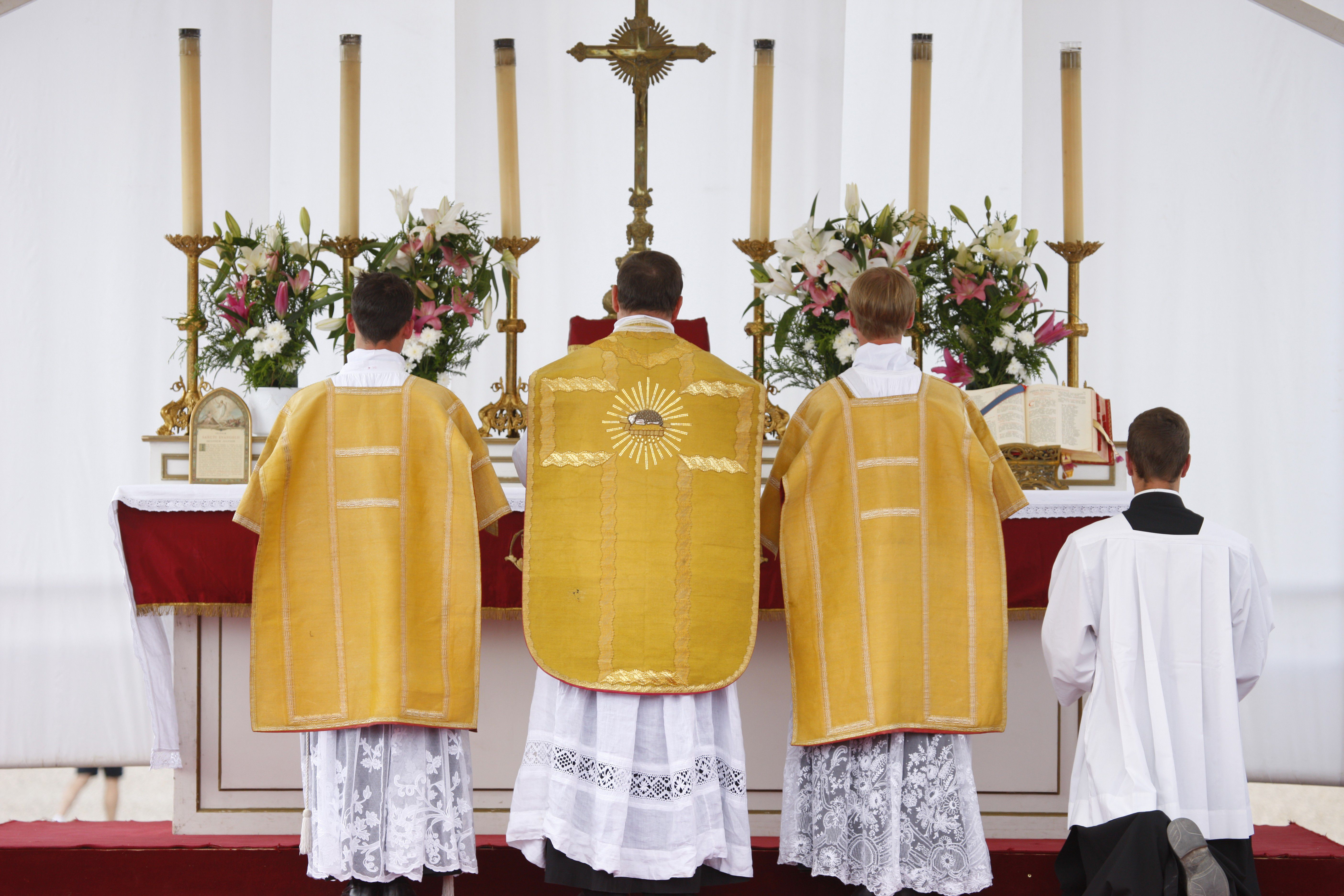 Celebrant and attendants at the altar during a traditional Mass