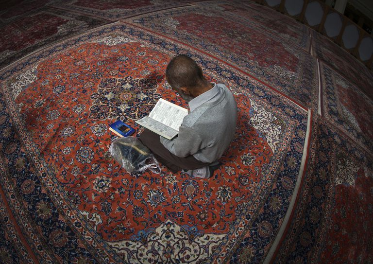 A man reading in a mosque