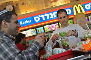 Two men enjoy lunch at a kosher McDonald's in Israel.