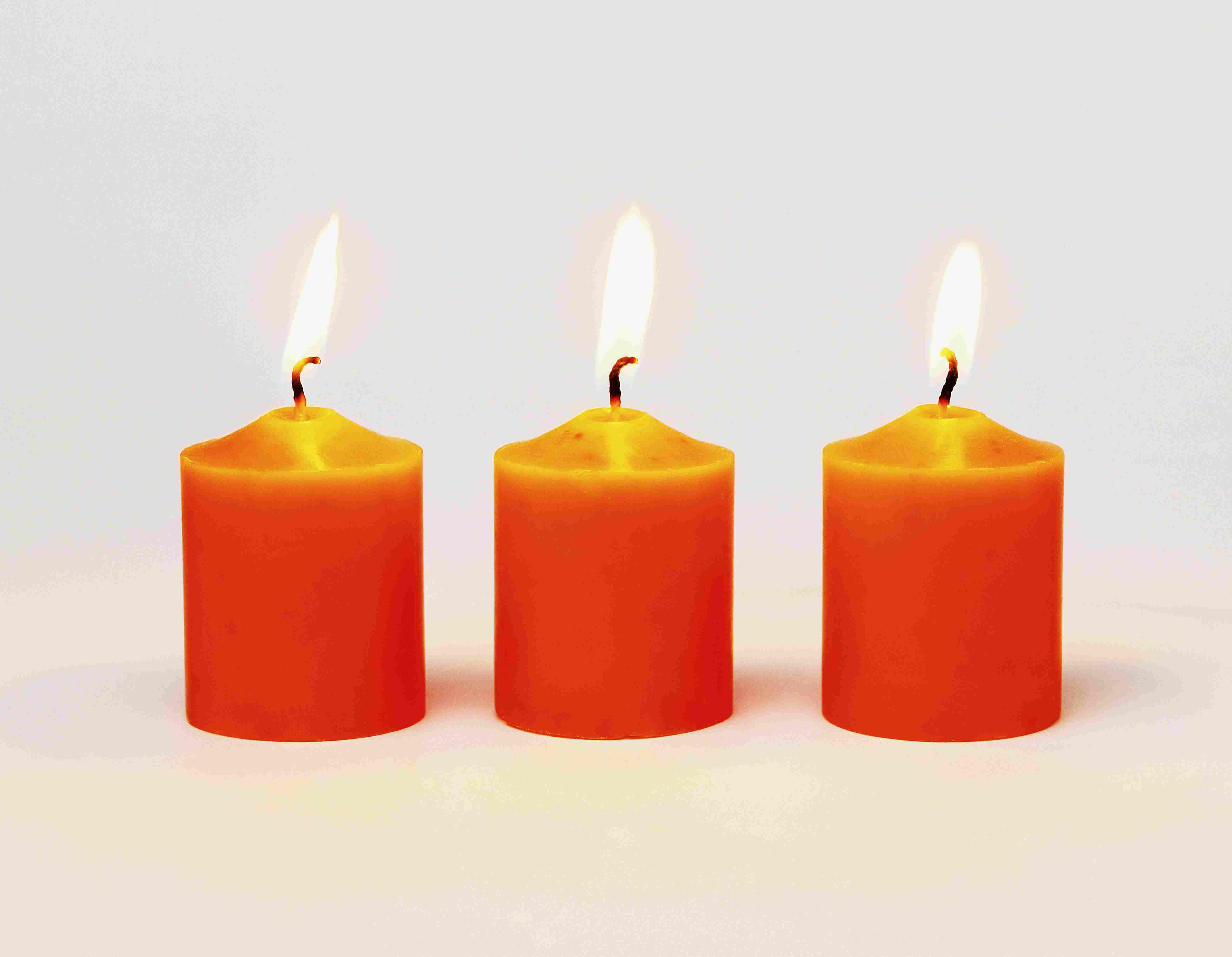 Three lit orange candles