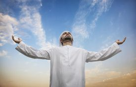 Middle eastern man praying to Allah