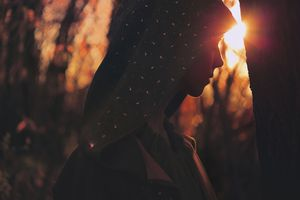 Woman in Cloak at Sunset
