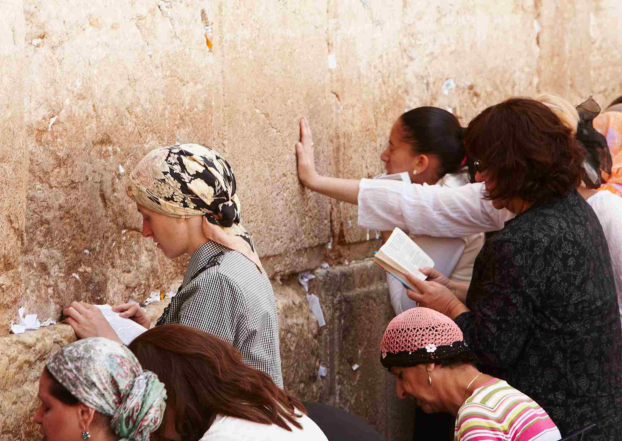 Women at the Kotel in Jerusalem during the day.