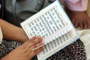 Woman reading Sikh holy book