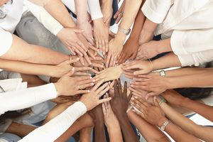 Hand of Diverse Women Huddling