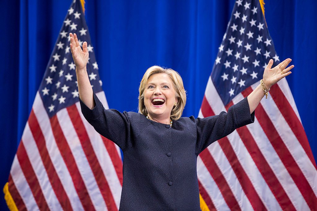 Democratic presidential candidate Hillary Clinton raises her arms stands on stage during the New Hampshire Democratic Party Convention at the Verizon Wireless Center on September 19, 2015 in Manchester, New Hampshire.