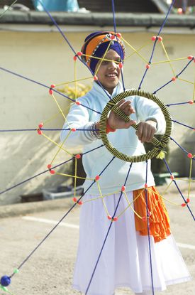 A Sikh boy participating in a gatka performance, the Sikh martial art, in Wolverhampton, England.