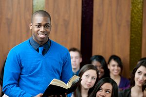 young man in church holding bible