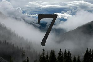 the number 7 among fog and clouds