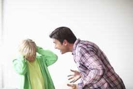 A man yelling at a child