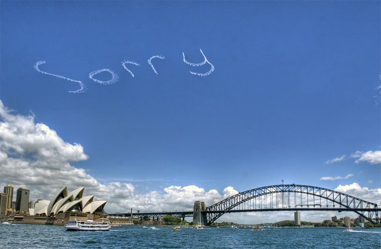 """Sorry"" written in skywriting above the Sydney Opera House."