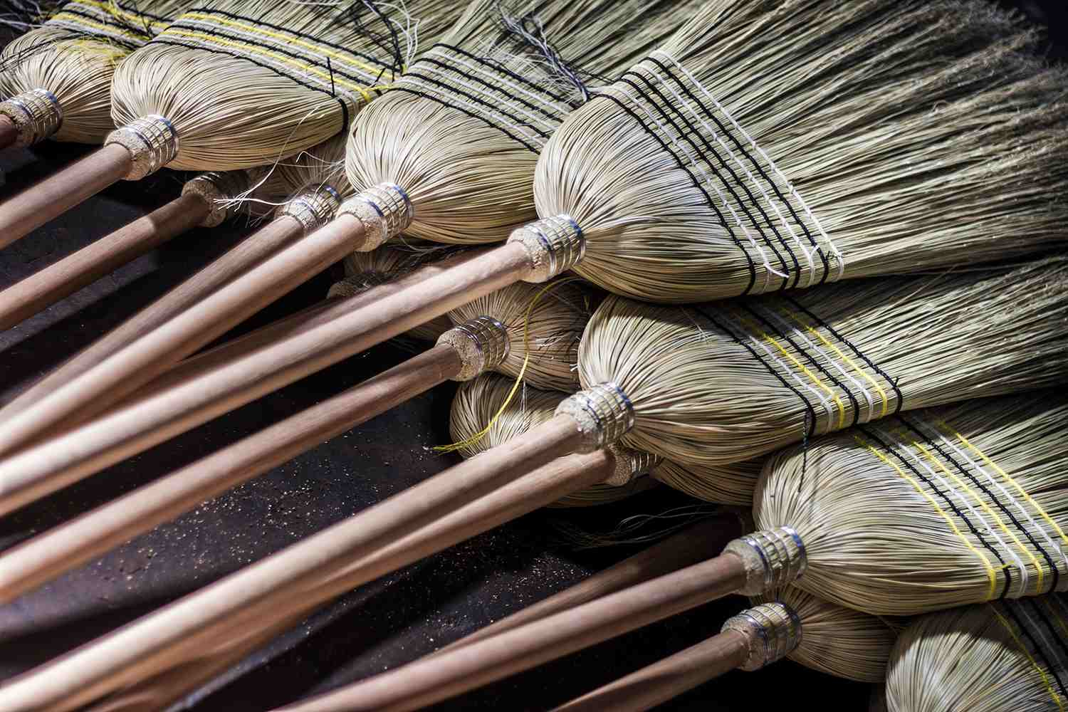 High Angle View Of Brooms For Sale In Market