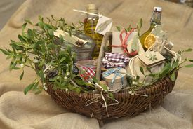 Hamper containing gift items, decorated with mistletoe